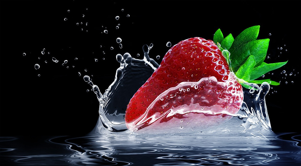 Strawberry splashing on water