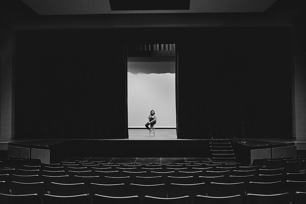 senior girl on a theater stage