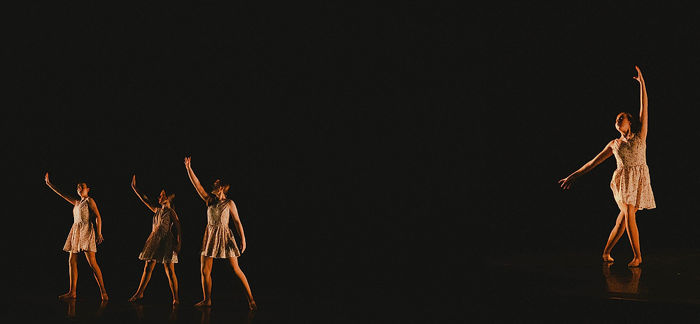 portraits of girl dancers during a dance recital