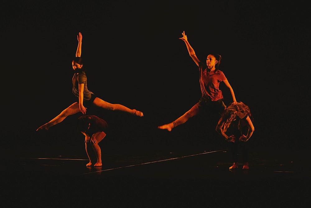 dancer girls leaping in a dance recital