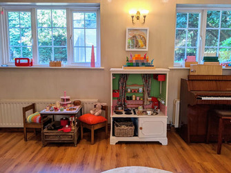The play kitchen and table set up for tea time