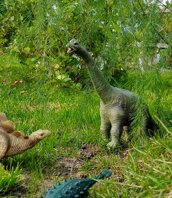Dinosaurs in the grass