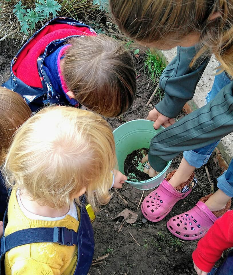 Children looking for worms