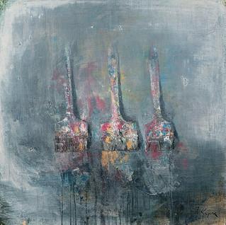 Three paintbrushes