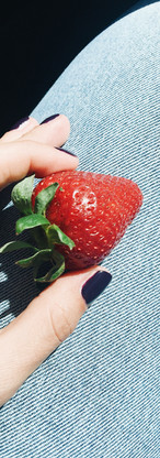 Holding a Strawberry