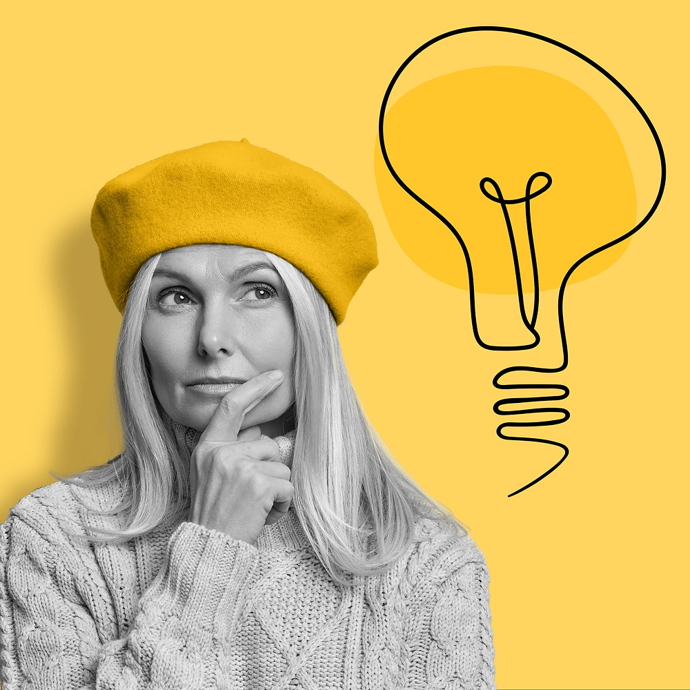 Woman holding her chin wearing a yellow beret thinking about ideas to get creative on yellow background with black light bulb sketch