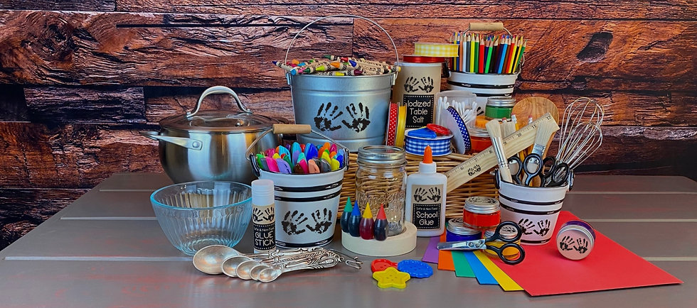 arts and crafts supplies to have on hand for artsy craftsy fun including caryons, markers, ribbon, colored pencils, acrylic paint pots, no-slip grip scissors, glue stick, food coloring, white glue, colored paper, ruler, paintbrush, buttons, pot with lid, measuring spoons, mixing bowl