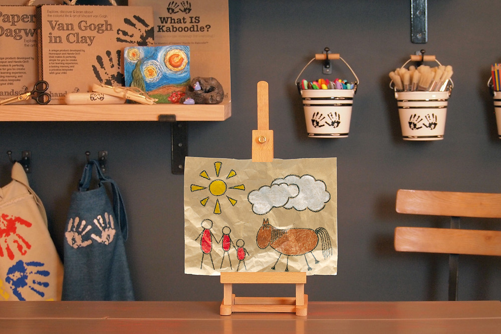 finished Cave Art Craft on easel in Art to Know with MommyO vlog set