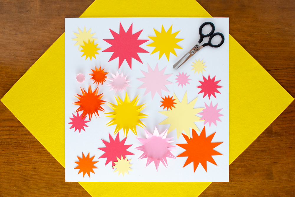 Paper Art Chrysanthemums step 3 with yellow, pink, orange and red flower shapes with folded petals, scissors