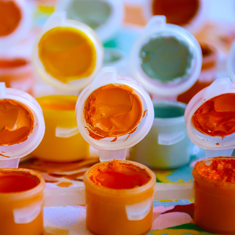 Paints in small plastic cups used for painting by numbers
