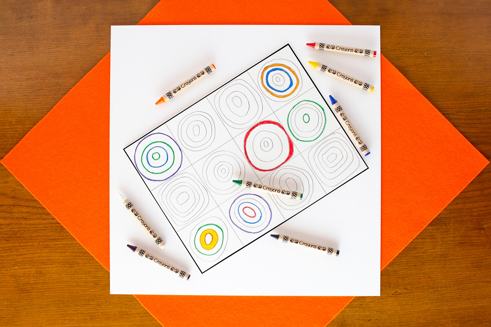 Painted Concentric Art step 2 with pencil drawing of concentric circles in squares partially colored, colorful crayons