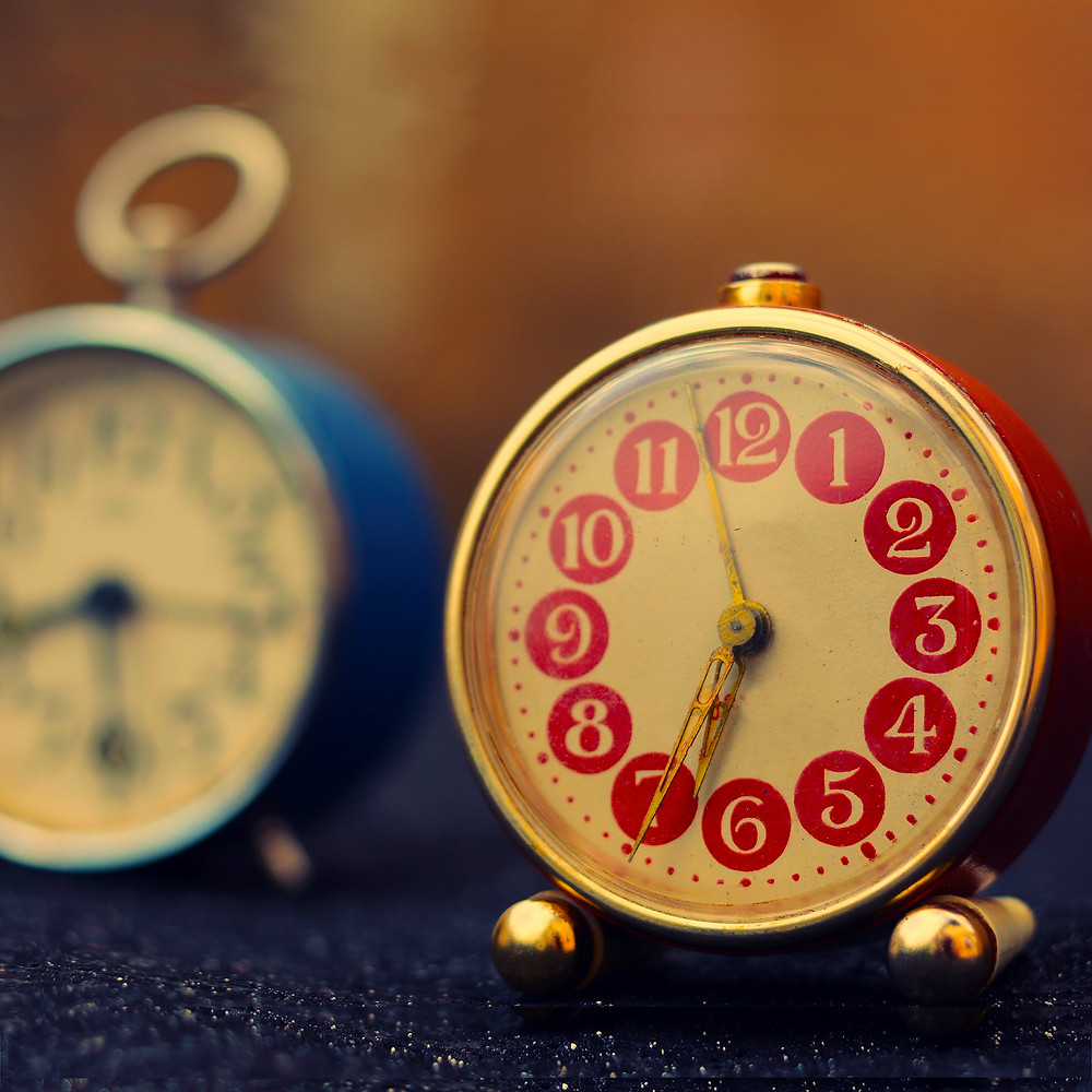 alarm clock with red numbers as reminder to make time for a creative outlet