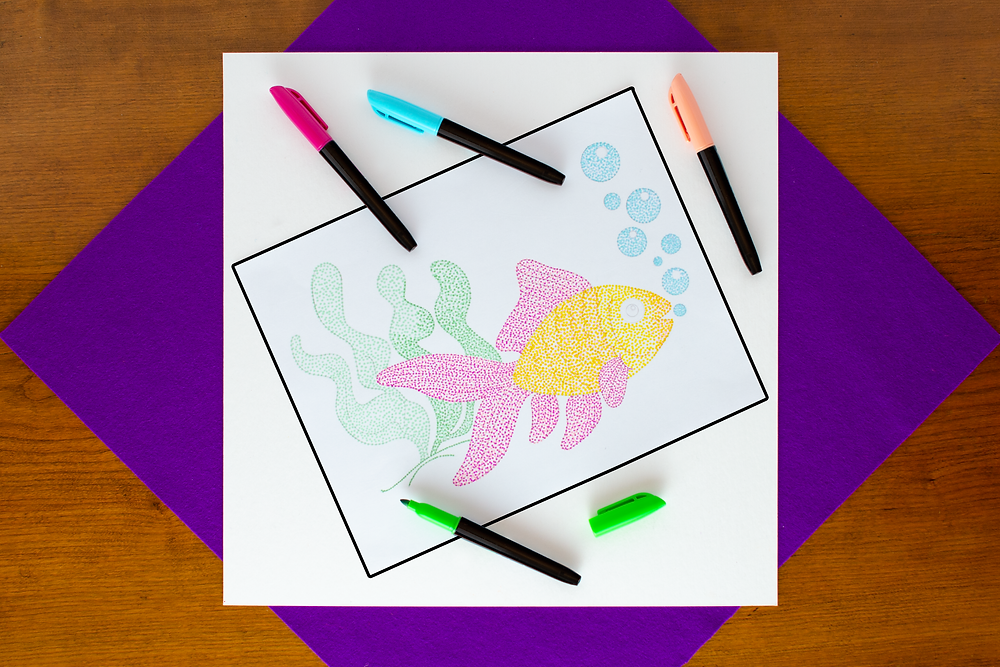 step 5 of Pointillist Marker Art Craft with fish outline, magenta, blue, peach, and green markers with many dots for blending