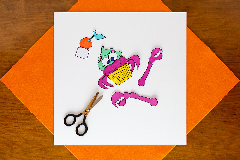 Surreal Creature Craft step 3 with colored in and cut out with a pair of scissors
