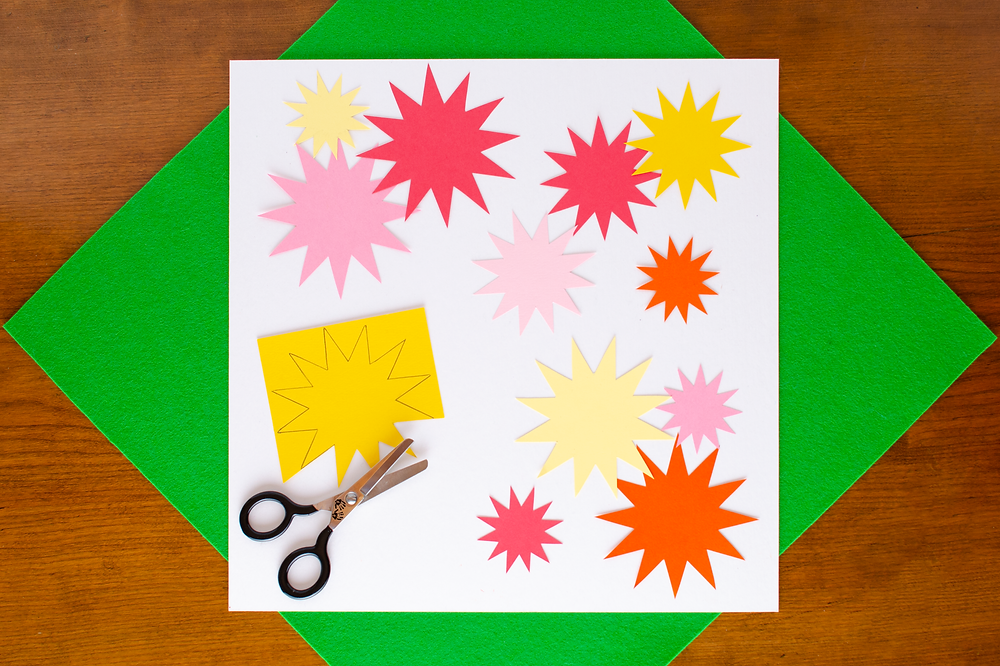 Paper Art Chrysanthemum step 2 with pink, yellow, orange and red flower cutouts, scissors