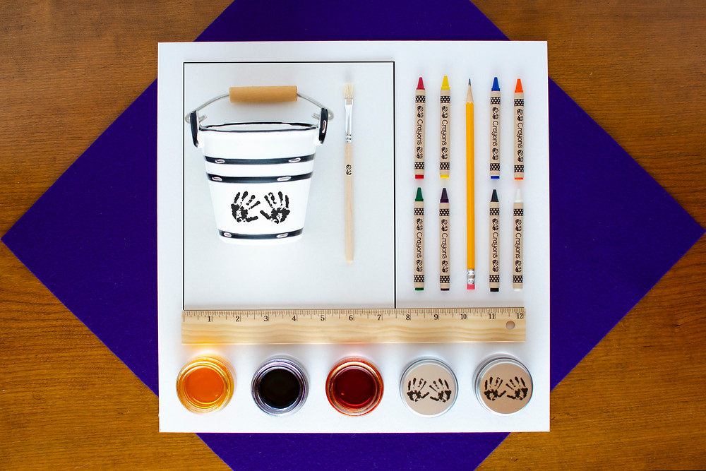 Painted Concentric Art materials with colorful watercolor paint and crayons, ruler, water bucket, paint brush, pencil