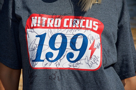 2 DVD's and a tee signed by the whole Nitro Circus crew