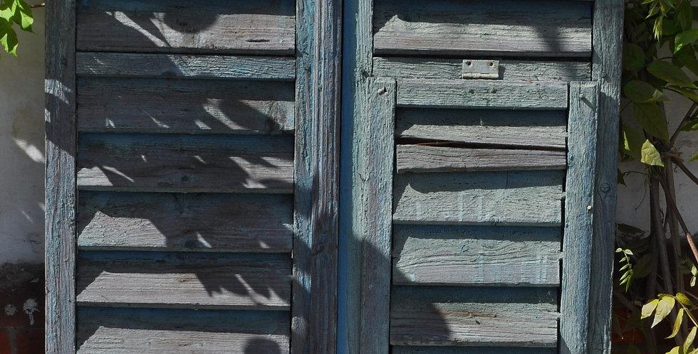 A PAIR OF  BLUE WINDOW  SHUTTERS