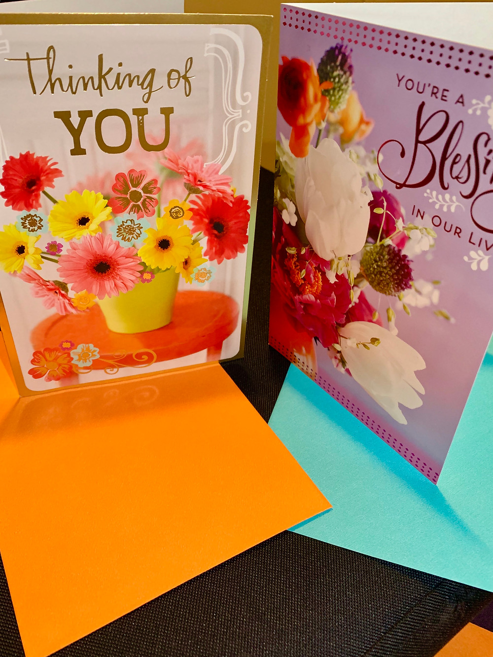 2 greeting cards. 1 says Thinking Of you, 1 says You Are A Blessing In Our Life.
