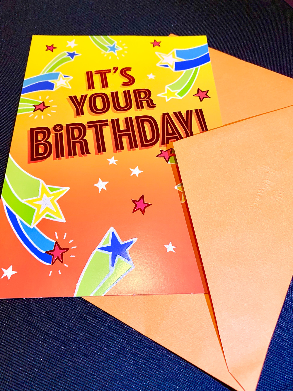 It is a yellow birthday card that says It's Your Birthday