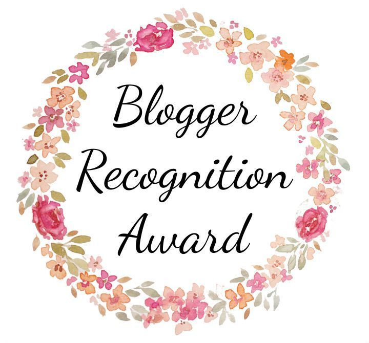 Flower boarder with blogger recognition award in the center