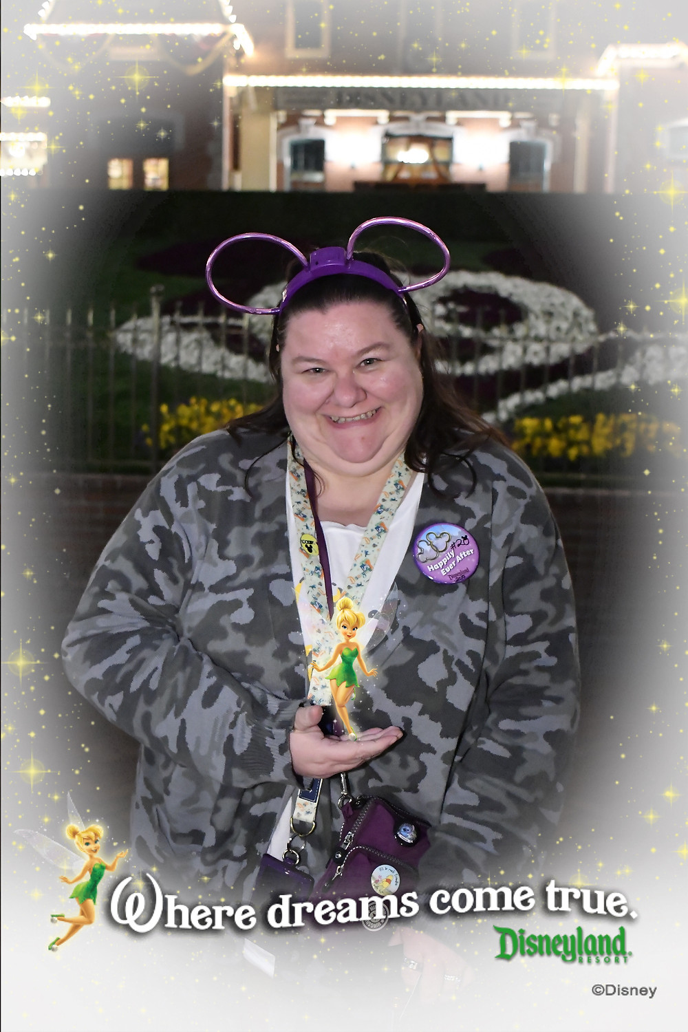 Melissa from Disabled Disney at Disneyland holding Tinkerbell