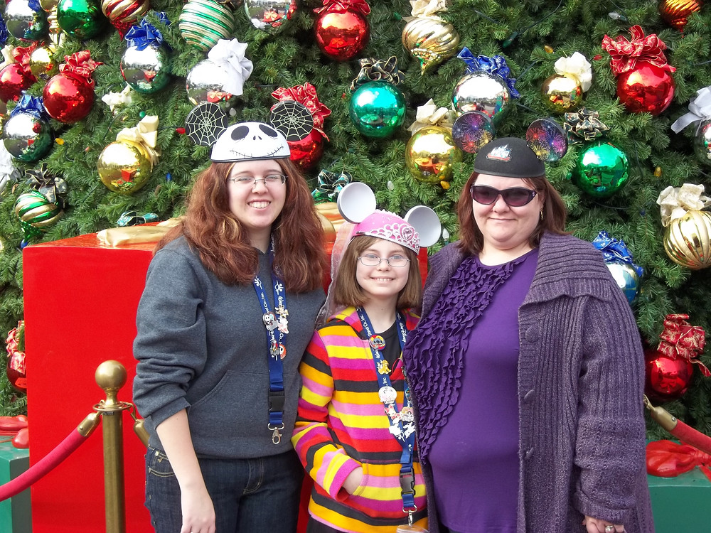 3 women in front of a Christmas tree