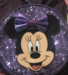 a purple purse with Minnie Mouse on it
