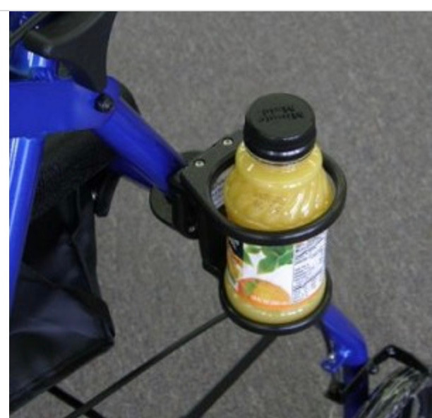 a cup holder on a walker with a bottle of orange juice
