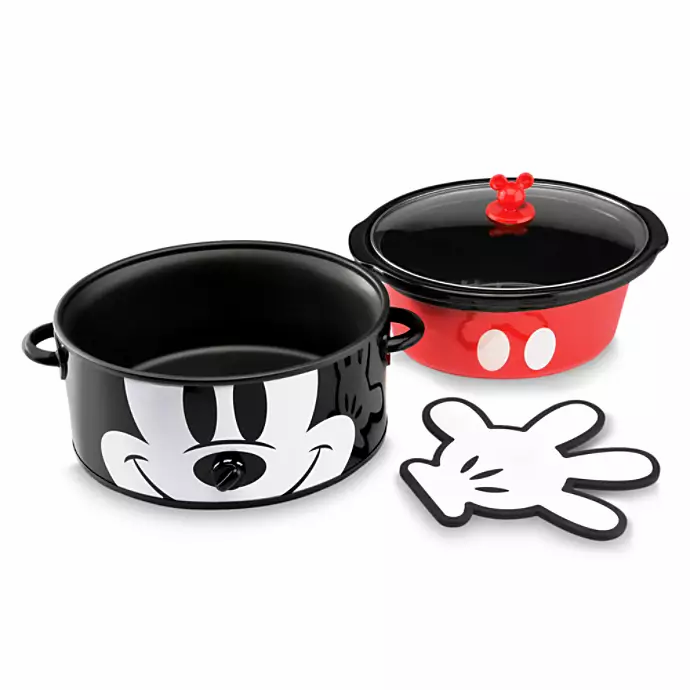 A Mickey Mouse themed crock pot. Exterior is black with Mickey's face and interior pot is red with 2 white dots