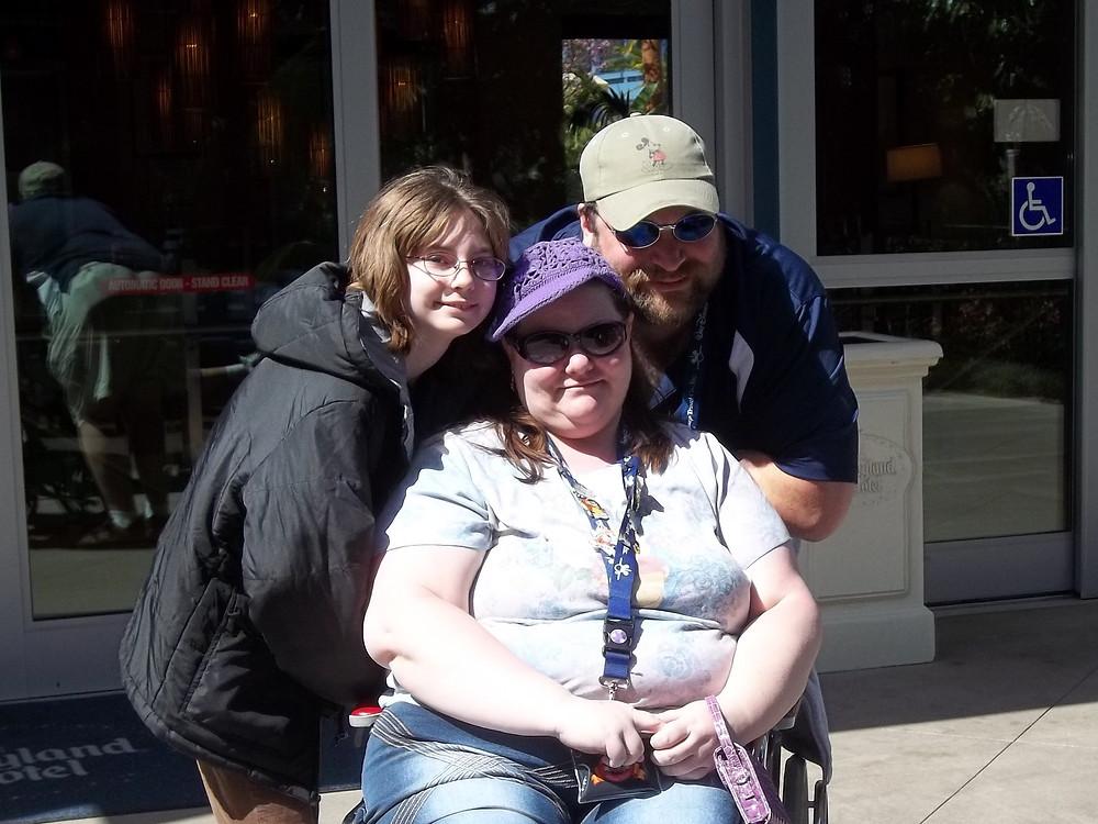 3 people. 1 in wheelchair