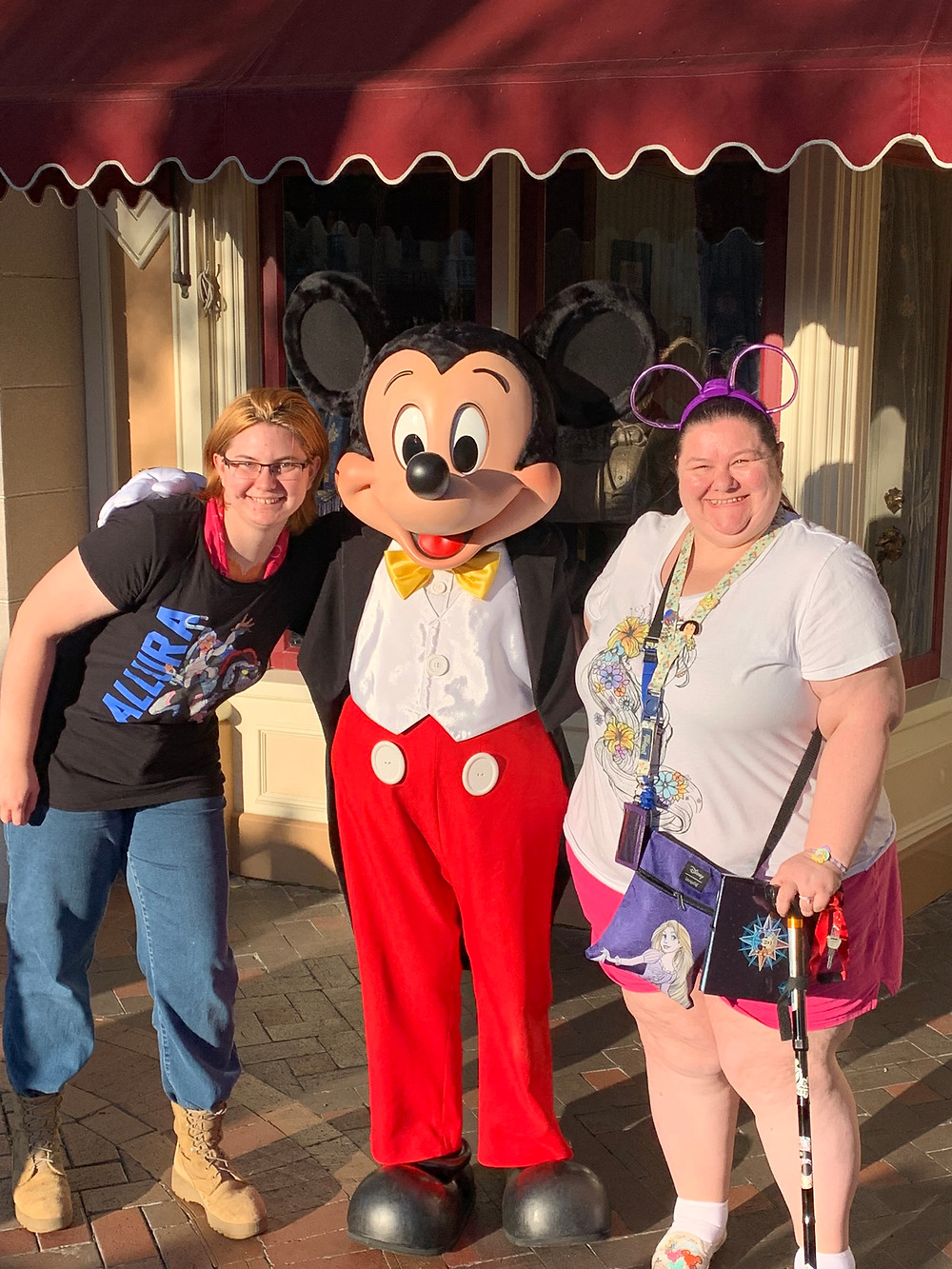 2 woman and Mickey Mouse