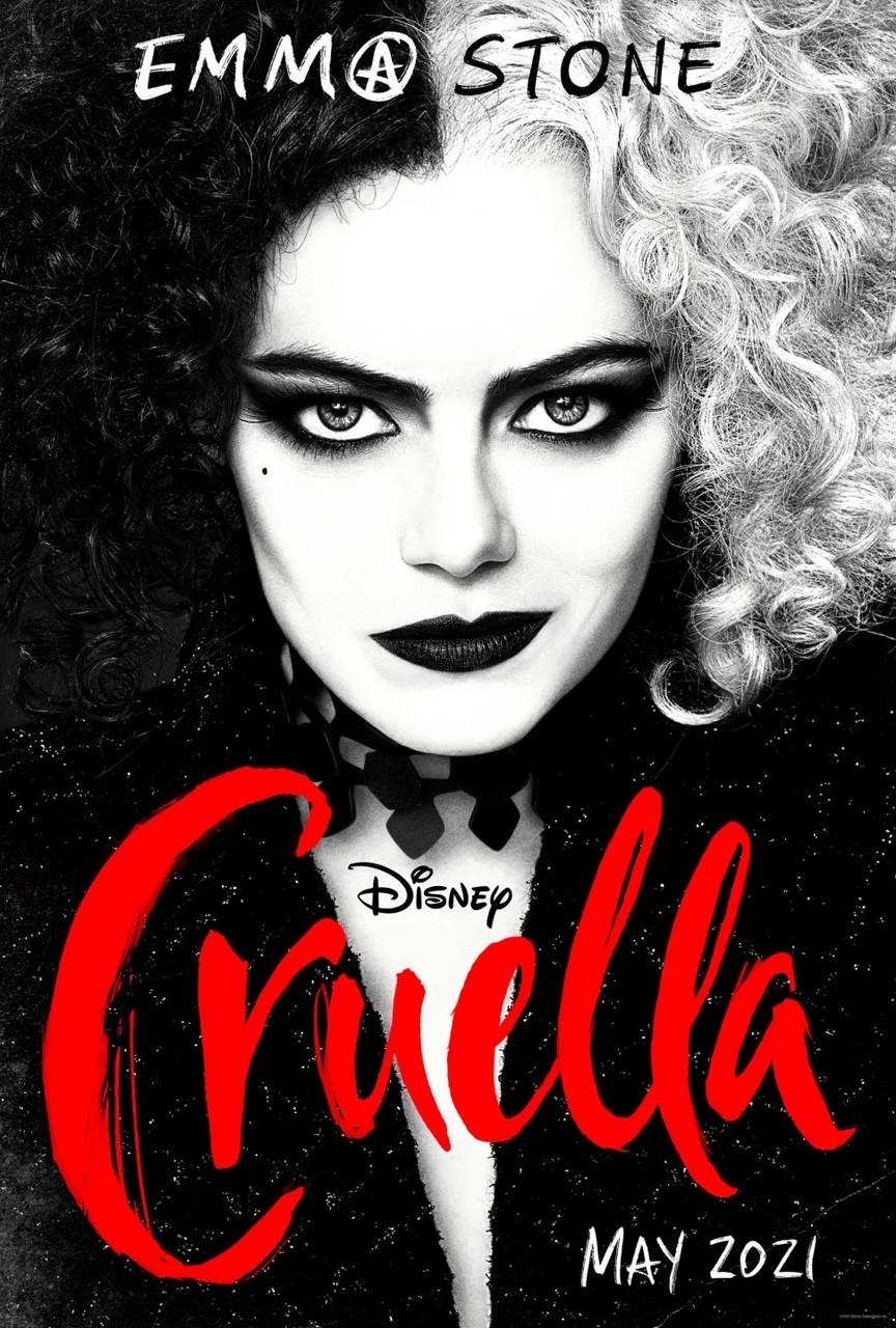 wpman with half white hair, half black hair wearing black with writing Disney's Cruella May 2021