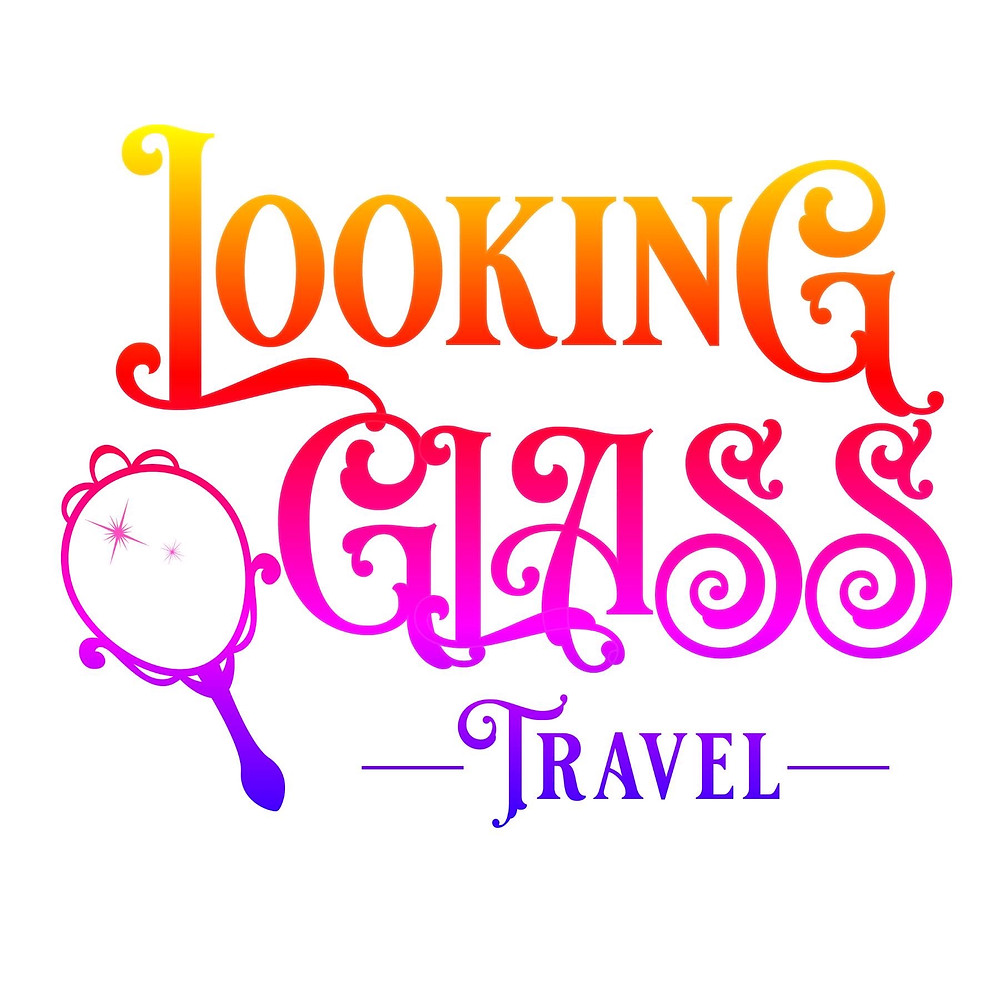 words say Looking Glass Travel and a hand held mirror