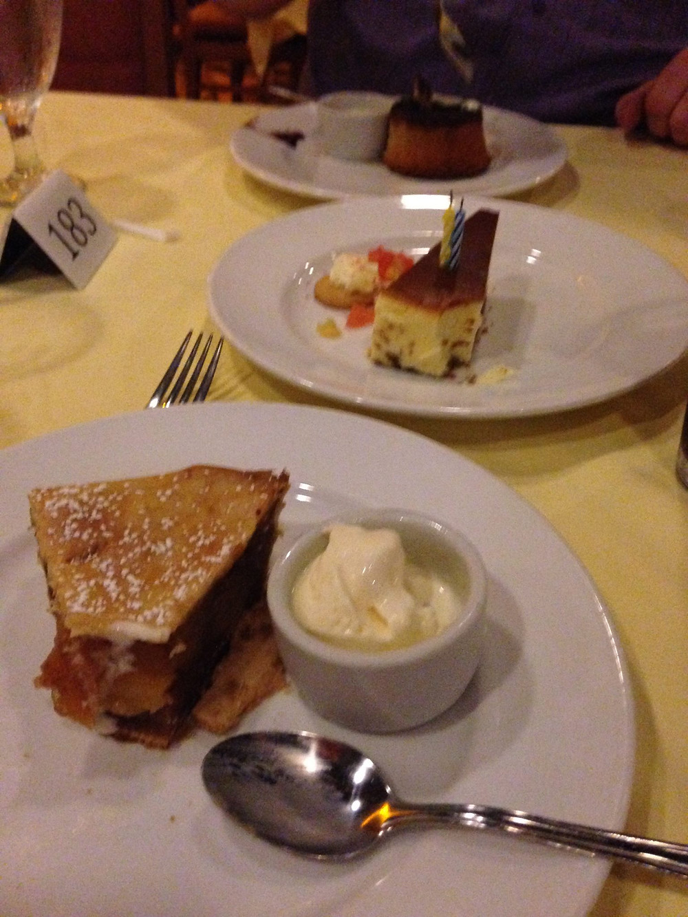 Cheesecake, mousee and apple pie desserts on board