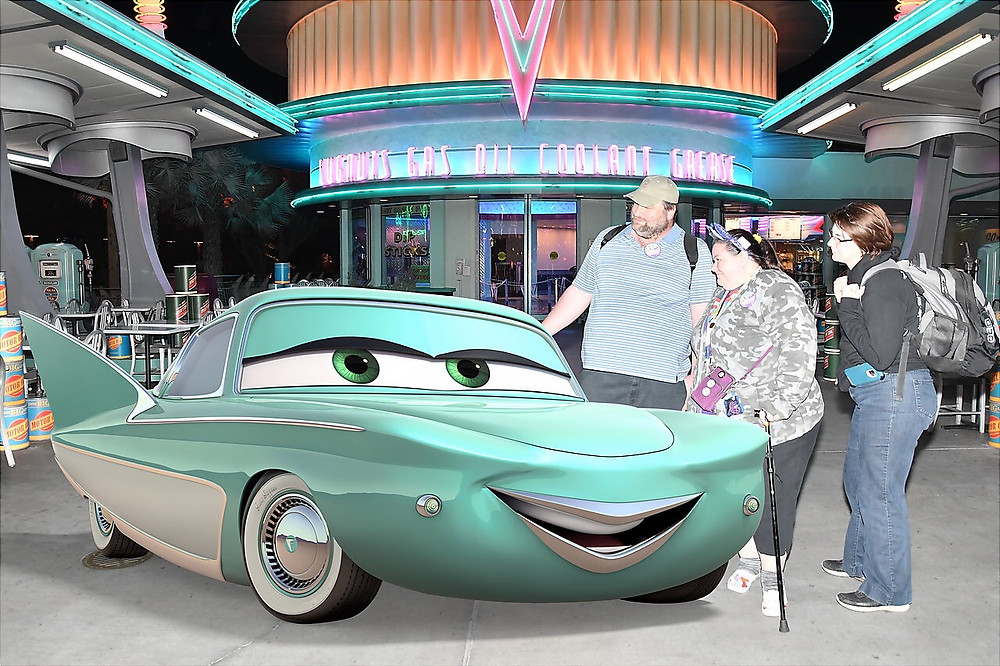 3 people and Flo from Cars at Disneyland