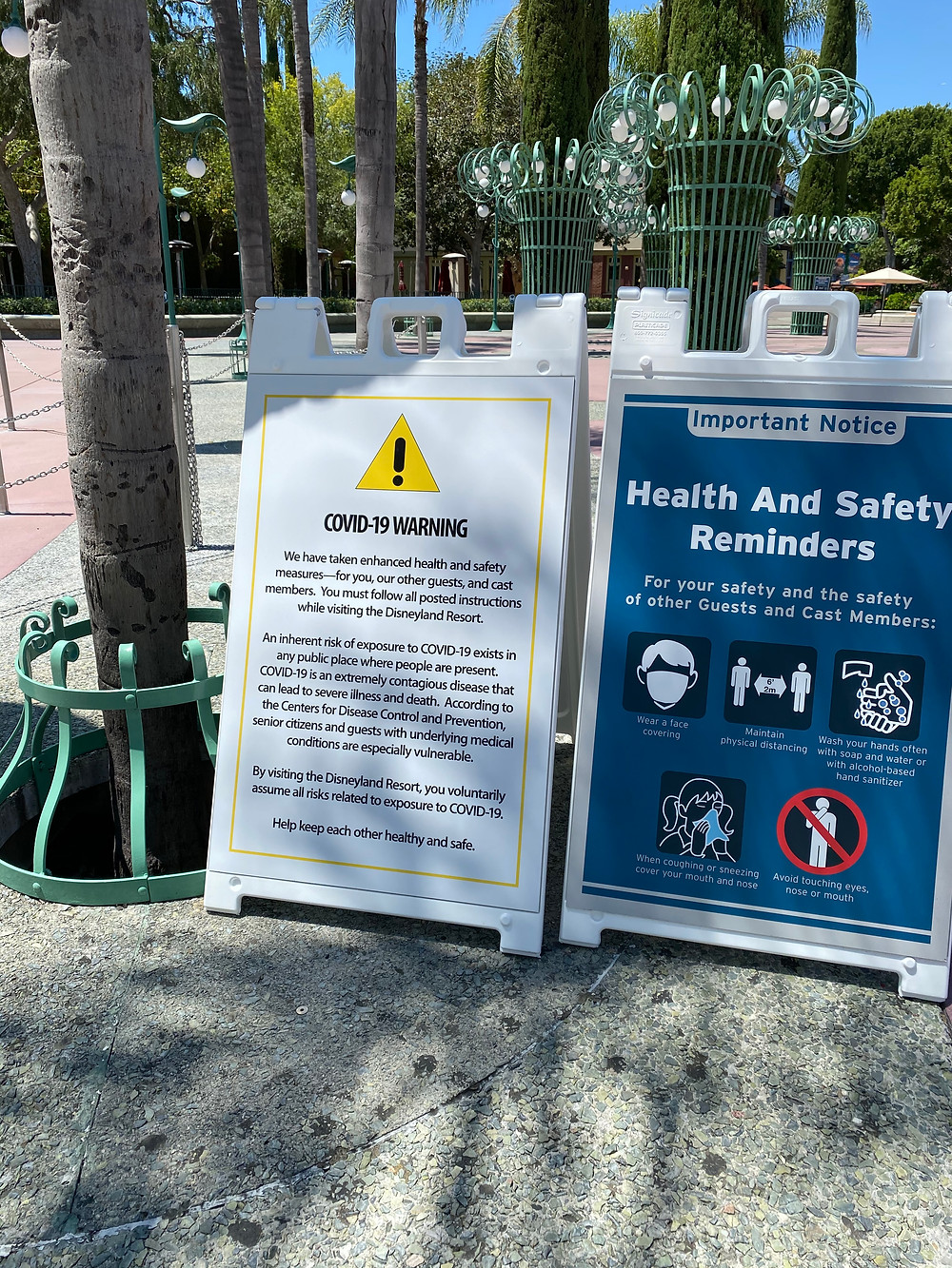 Signs with health and safety regulations for Downtown Disney and COVID warning