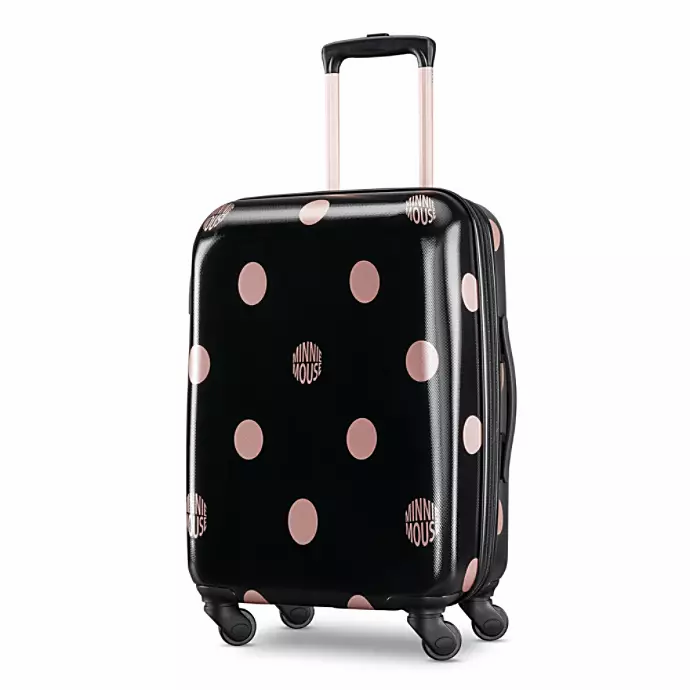 Black suitcase with pink dots