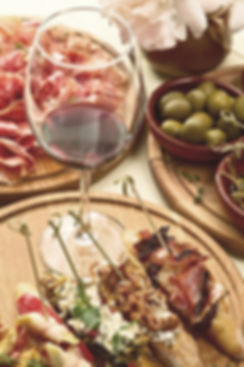 Glass of red wine paired with appetizers