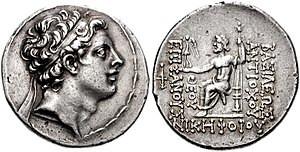 Coin depicting Antiochus IV, Greek inscription reads ΘΕΟΥ ΕΠΙΦΑΝΟΥΣ ΝΙΚΗΦΟΡΟΥ / ΒΑΣΙΛΕΩΣ ΑΝΤΙΟΧΟΥ (King Antiochus, image of God, bearer of victory)