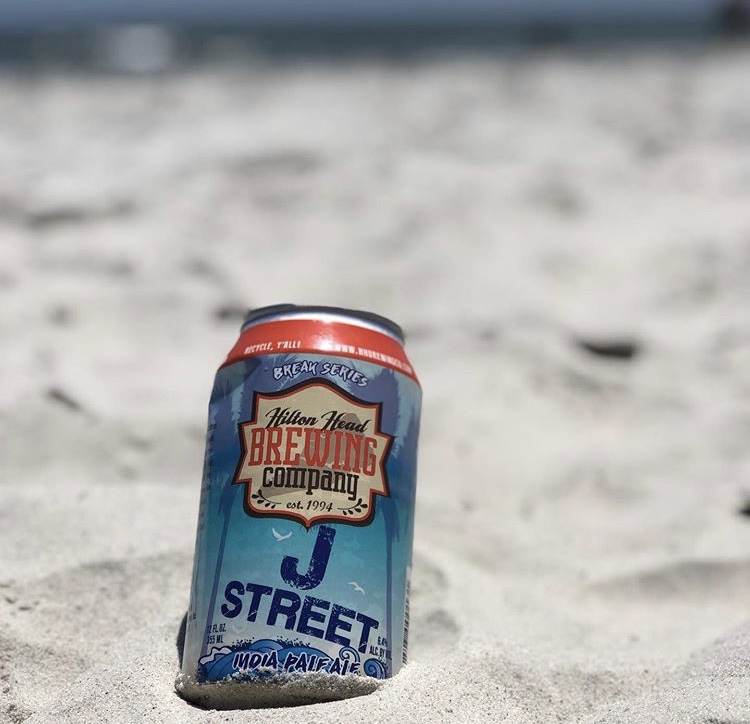 HHBC can in sand