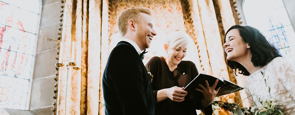 Humanist wedding ceremony, couple laughing and smiling