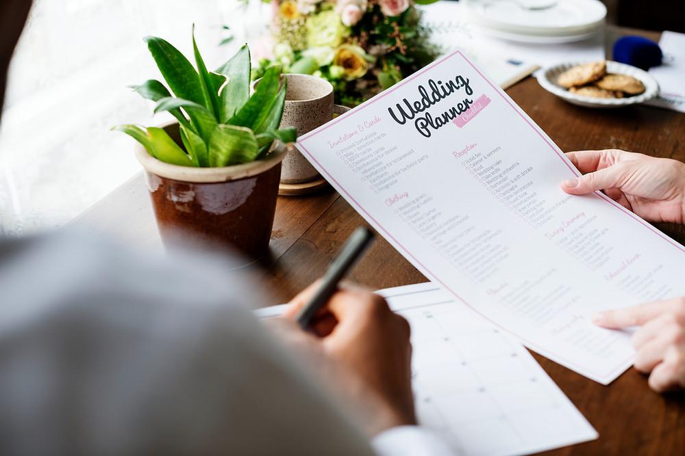 hands holding a best wedding planning sheet