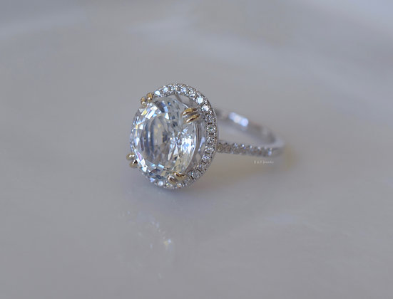 Halo Style Oval White Topaz And Diamond Engagement Ring