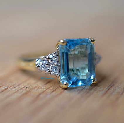Emerald Cut Sky Blue Topaz And Diamond Ring