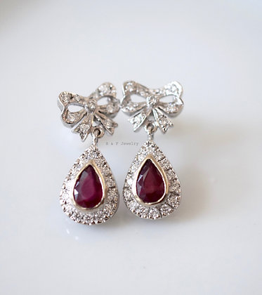 14K White Gold Ruby And Diamond Earrings- Has matching necklace.