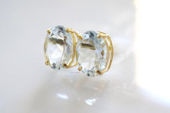 14K Gold Oval Sky Blue Topaz Stud Earrings