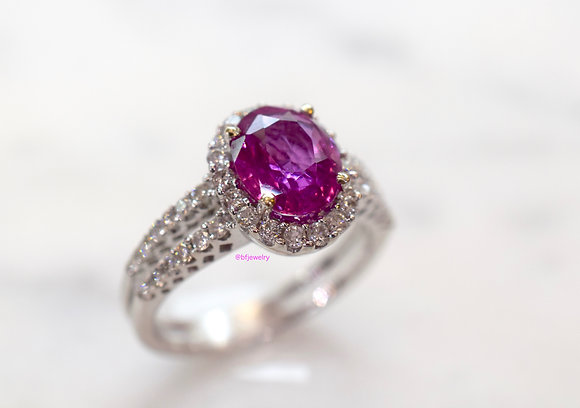 Halo Style Oval Pink Sapphire And Diamond Ring