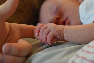 baby-holding-human-finger-225744.jpg