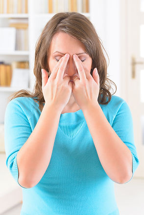 Woman doing EFT on the eye brow point. E